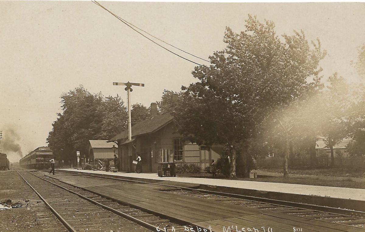 McLean Depot, circa 1912. Erected in 1855, it is said to have been the first building in McLean. The double tracks shown here were completed from Chicago to St. Louis around 1909. The depot was moved in 1971 to its present location across from the Dixie.