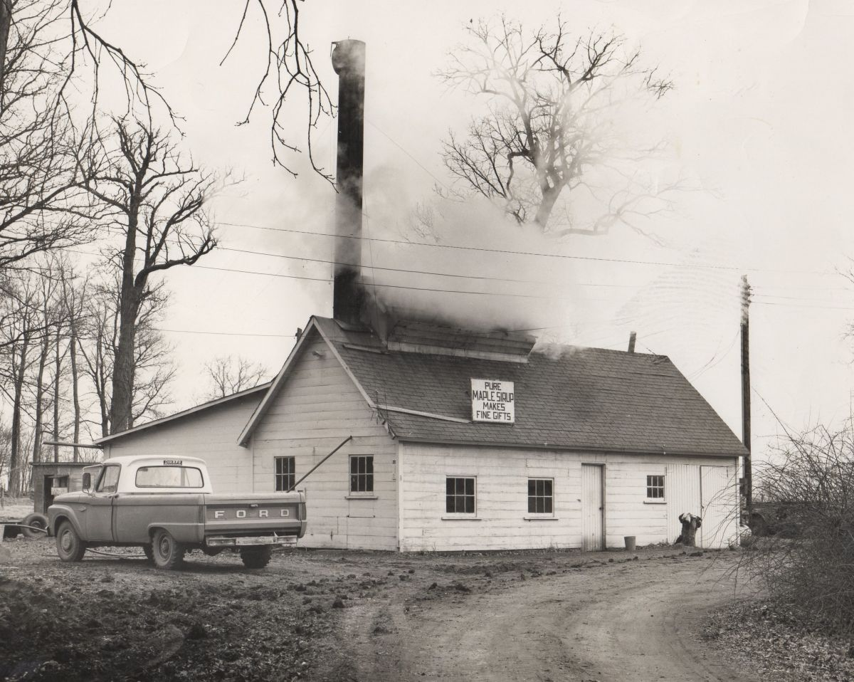 Funks Grove Pure Maple Sirup, 1967. This sugarhouse (built 1930) was in use until 1988 and had cooking, evaporator, and storage rooms, but no sales room. Instead, sirup was sold from the enclosed porch on Stephen & Glaida Funk's home on the same property.