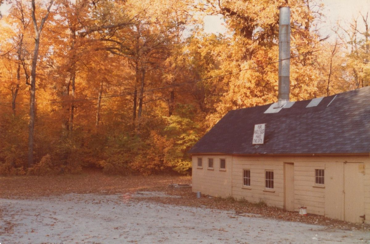 Funks Grove Pure Maple Sirup, 1978. This is the sugarhouse built in 1930, with a newer cooking room visible at the end of the building. The current sugarhouse, built in 1988, used this cooking room until it was replaced with a commercial kitchen in 2017.