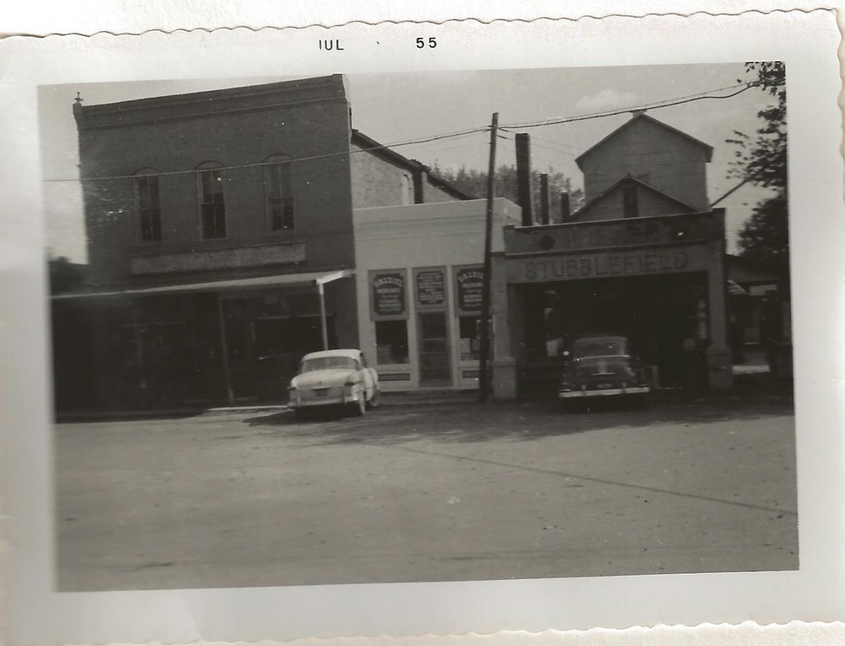 Village Square, Park St., 1955. James T. Dalziel set up his barbershop in the white building in 1916 and in 1928 set up an insurance office in the back. After he retired in 1950, his wife and then his son, Jim Jr., took over the insurance agency.