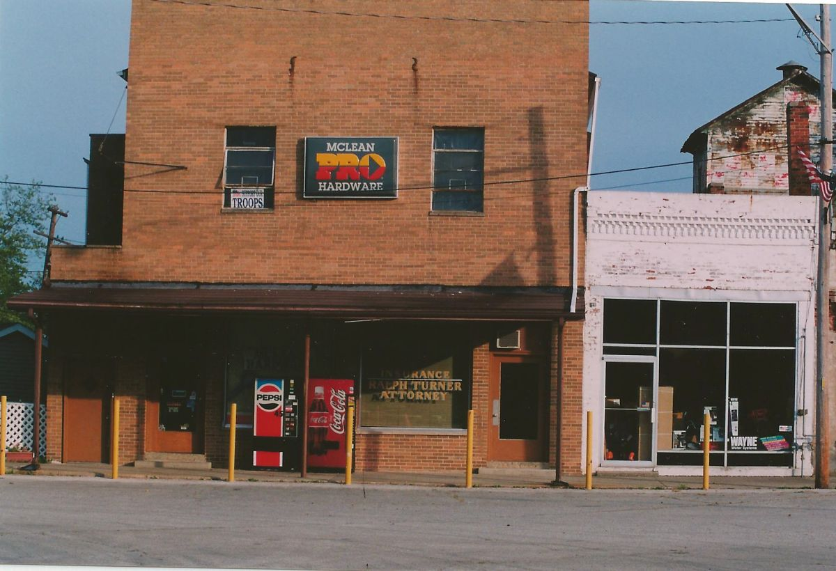 Village Square, Park St., circa 2000. Today, McLean Hardware store is open, operated by Scott & Sandy Sheldon. Attorney Ralph Turner used the center office for many years, until he passed away in 2019. The other buildings have since been demolished.